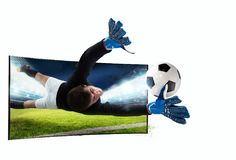 Realism of sporting images broadcast on tv. Soccer player comes out of the tv to catch the ball stock illustration