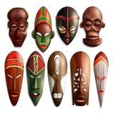 Realistic African Masks Set. Set of realistic african carved masks from wood with colorful ornament on white background isolated vector illustration royalty free illustration
