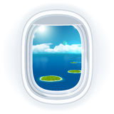 Realistic aircraft porthole (window) with blue sea or ocean in it and small tropical islands. Royalty Free Stock Image