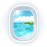 Realistic aircraft porthole (window) with bright sea or ocean in it and tropical island. Stock Photography