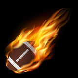 Realistic american football in the fire. Royalty Free Stock Photos