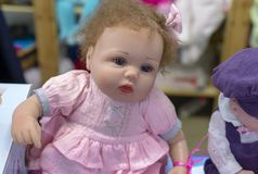 Realistic baby doll in the toy store royalty free stock image