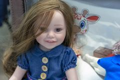 Realistic baby doll in the toy store royalty free stock photography