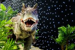 Realistic of beautiful dinosaur model in the theme park royalty free stock photography