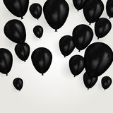Realistic black birthday balloons flying for party or celebrations. Space for message. Isolated on light background. Stock Images