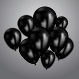 Realistic black birthday balloons flying for party or celebrations. Space for message.  on light background. Stock Images