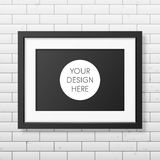 Realistic black frame A4 on the brick wall Royalty Free Stock Photos