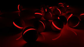 Realistic black glossy plastic spheres with red luminescent cores. Realistic black glossy plastic spheres with red luminescent cores background. Technology Royalty Free Stock Image