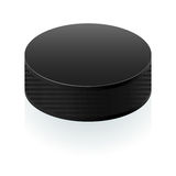 Realistic black puck Stock Image
