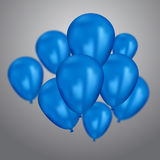 Realistic blue birthday balloons flying for party or celebrations. Space for message. Isolated on light background. Stock Photos