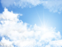 Realistic blue sky with white clouds and sun rays Stock Images