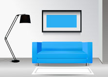 Realistic blue sofa with floor lamp, carpet and photoframe on the wall. Interior illustration.Furniture Design Concept. Royalty Free Stock Photos