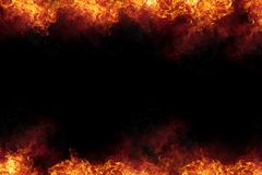 Burning Fire Flames Frame on Black. Realistic burning fire flames frame border, sparks and smoke with copy space, explosion effect on black background Royalty Free Stock Photo
