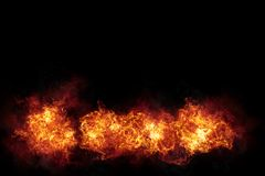 Realistic Burning Fire Flames with Smoke on Black. Realistic burning fire flames with sparks and smoke with copy space, explosion effect on black background Royalty Free Stock Photos