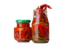 Realistic canned chilli pepper, izolated on white background. Asian market. Opened glass jar of mexican food. Royalty Free Stock Images