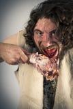 Realistic Caveman Eating Stock Image