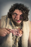 Realistic Caveman Eating Royalty Free Stock Images