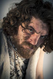Realistic Caveman. Silly realistic caveman with dirty face Royalty Free Stock Photography