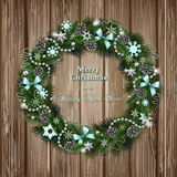 Realistic Christmas wreath on wood background Royalty Free Stock Photo