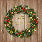 Realistic Christmas wreath on wood background Stock Image