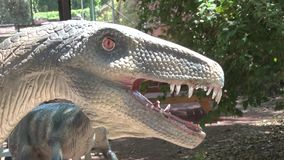 Realistic coelophysis dinosaur in dino park Head. This is footage of Realistic coelophysis dinosaur in dino park Head stock footage