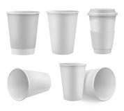 Realistic coffee cup mock up set. Realistic paper coffee cup mock up set isolated on white background vector illustration. Blank white 3d model takeaway Royalty Free Stock Images