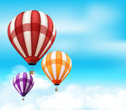 Realistic Colorful Hot Air Balloons Background Flying. In the Blue Sky with Clouds and Space for Writings. Vector Illustration Royalty Free Stock Photo