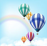 Realistic Colorful Hot Air Balloons Background Flying. In the Blue Sky with Colorful Rainbow and Clouds with Space for Writings. Vector Illustration Royalty Free Stock Photo