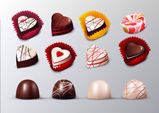 Realistic Confectionery And Pastry Elements Set. With chocolate candies in heart shape packaging and lollipop isolated vector illustration Royalty Free Stock Photography