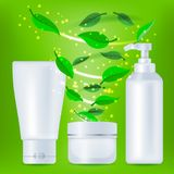 Realistic cosmetic bottles with green leafs Royalty Free Stock Image