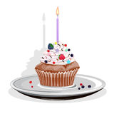 Realistic cupcake with candles Stock Images