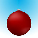 Realistic 3D red christmas ball decoration hanging on white chain. Rounded red ball decoration with reflections on blue to white gradient backdrop Royalty Free Stock Images
