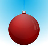 Realistic 3D red christmas ball decoration hanging. On white chain. Rounded red ball decoration with several white reflections on blue to white gradient Royalty Free Stock Image
