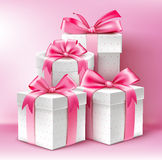 Realistic 3D White Gifts with Colorful Gold Ribbons Royalty Free Stock Photography