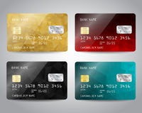 Realistic detailed credit cards set. With colorful gold, balck, red, blue triangular design background. Golden card. Vector template EPS10 Royalty Free Stock Photography
