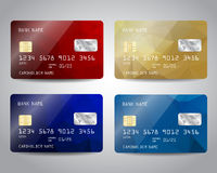 Realistic detailed credit cards set. With colorful gold, red, blue triangular design background. Golden card. Vector template EPS10 Royalty Free Stock Image