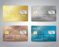 Realistic detailed credit cards set. With colorful gold, silver, bronze, turquoise triangular abstract design background. Golden card. Silver card. Bronze card Royalty Free Stock Image
