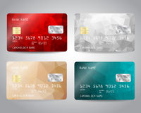 Realistic detailed credit cards set. With colorful red, silver, turquoise, bronze triangular design background. Vector template EPS10 Stock Image