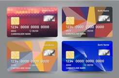 Realistic detailed credit cards set with colorful triangular design background. Stock Images