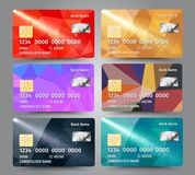 Realistic detailed credit cards set with colorful triangular design background. Vector illustration EPS10 Royalty Free Stock Photos