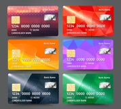 Realistic detailed credit cards set with colorful triangular design background. Vector illustration EPS10 Royalty Free Stock Image