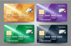 Realistic detailed credit cards set with colorful triangular design background. Stock Image