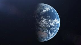 Realistic Earth rotation 360 degrees with the Sun light lens flare. Looped animation. 4K