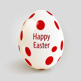 Realistic Easter egg with red spots. Happy Easter. Royalty Free Stock Image