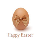 Realistic egg icon with ribbon, isolated on white Stock Images