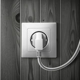Realistic electric white socket and plug on dark Stock Photos