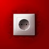 Realistic electric white socket on red wall Stock Photography