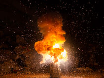 Realistic fiery explosion busting Stock Photography