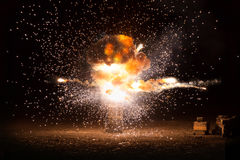 Realistic fiery explosion busting. Over a black background Royalty Free Stock Photo