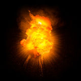 Realistic fiery explosion. With sparks over a black background Stock Images